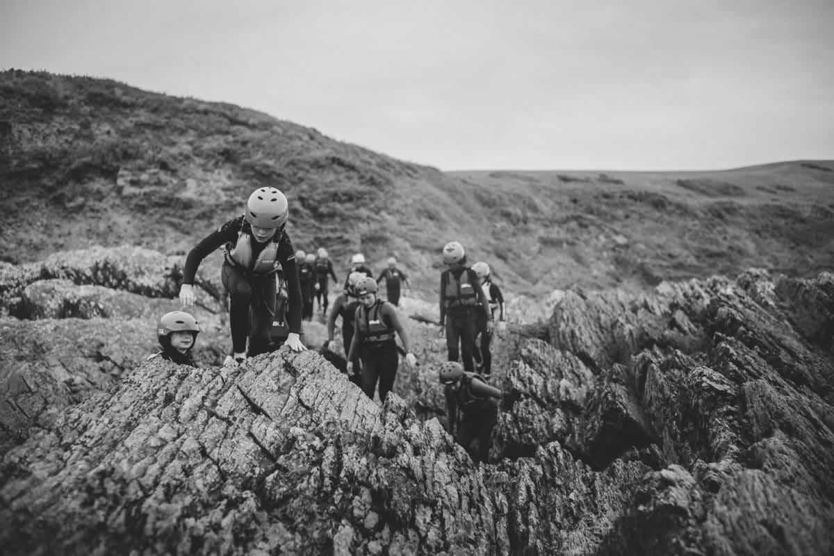 kids coasteering adventure along baggy point in a school trip